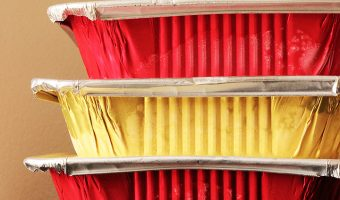 gold and yellow freezer meals stacked on table