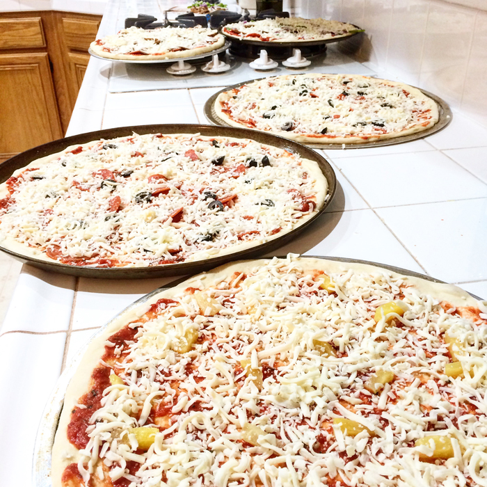 pizzas ready for baking sitting on counter