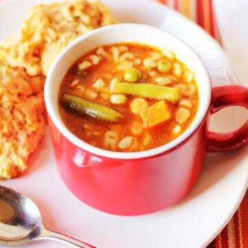 alphabet soup in red mug