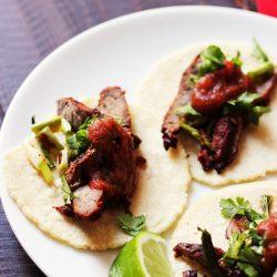 A plate of carne asada tacos
