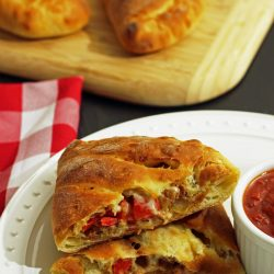 A plate of sausage calzones
