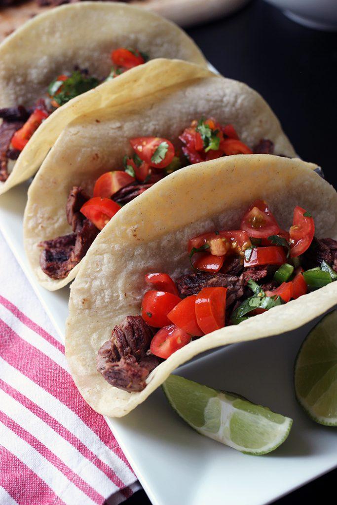 carne asada tacos in metal rack