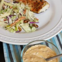 A bowl of Remoulade next to fish plate