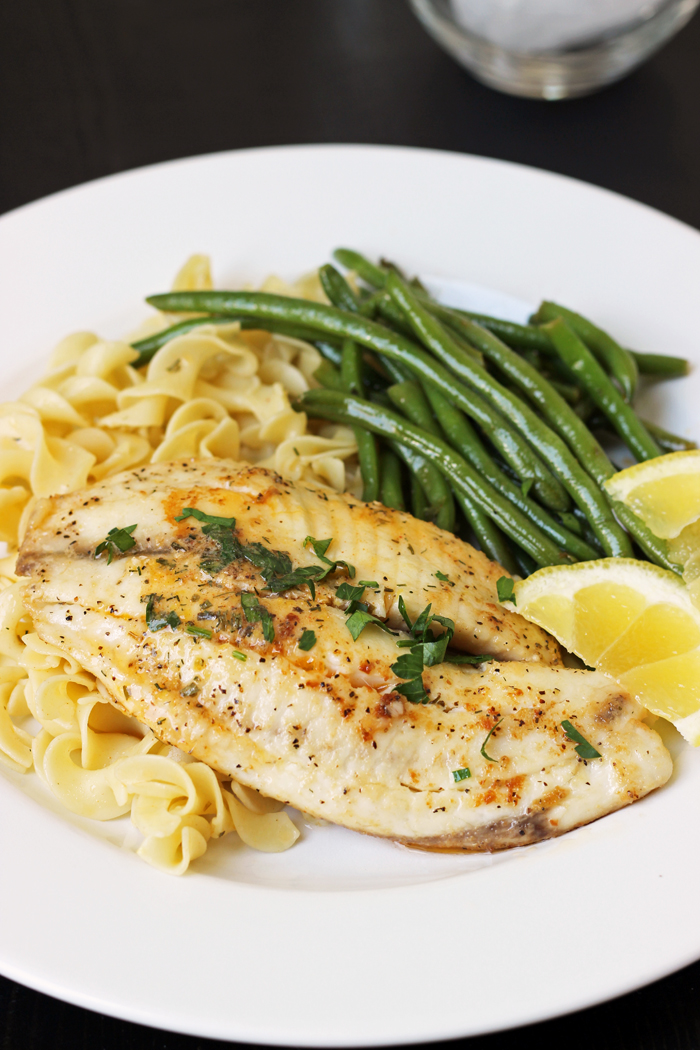 tilapia, green beans, and egg noodles on a plate