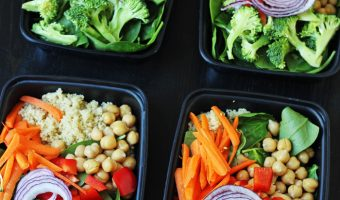 plastic containers packed with quinoa vegetable salad