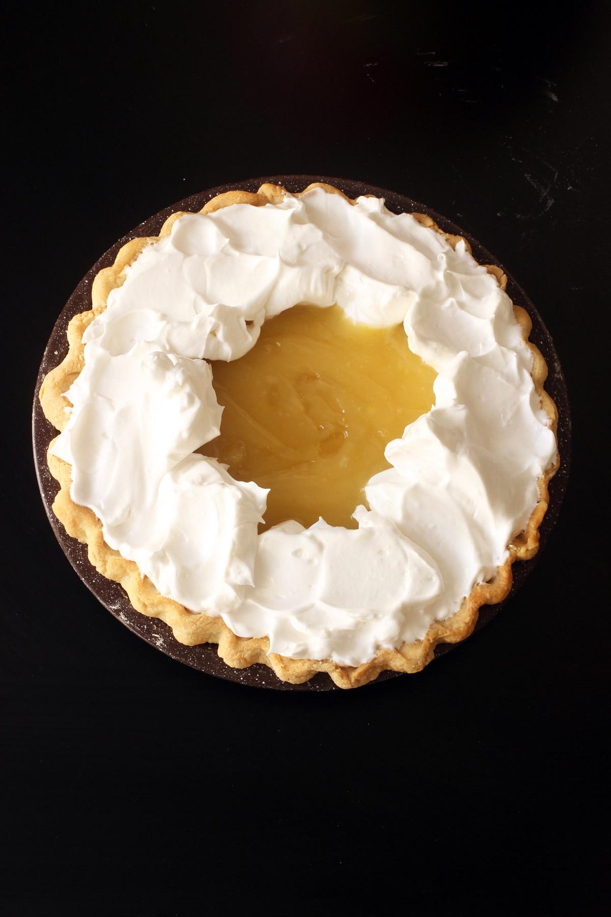 adding meringue to pie