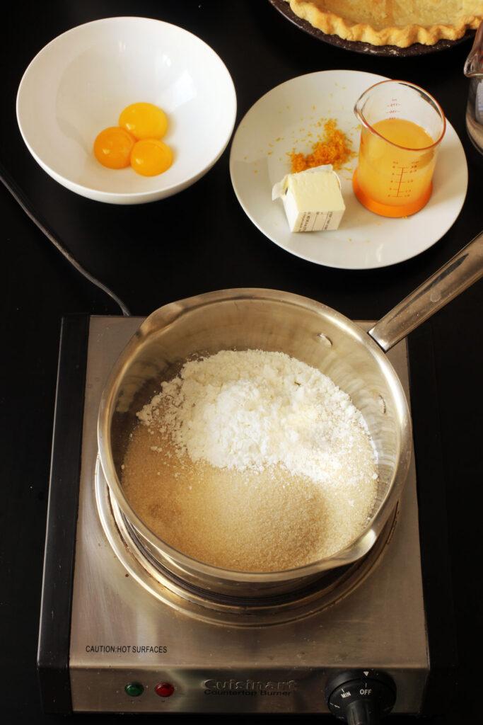filling ingredients near pot