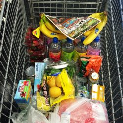 A shopping cart filled with food