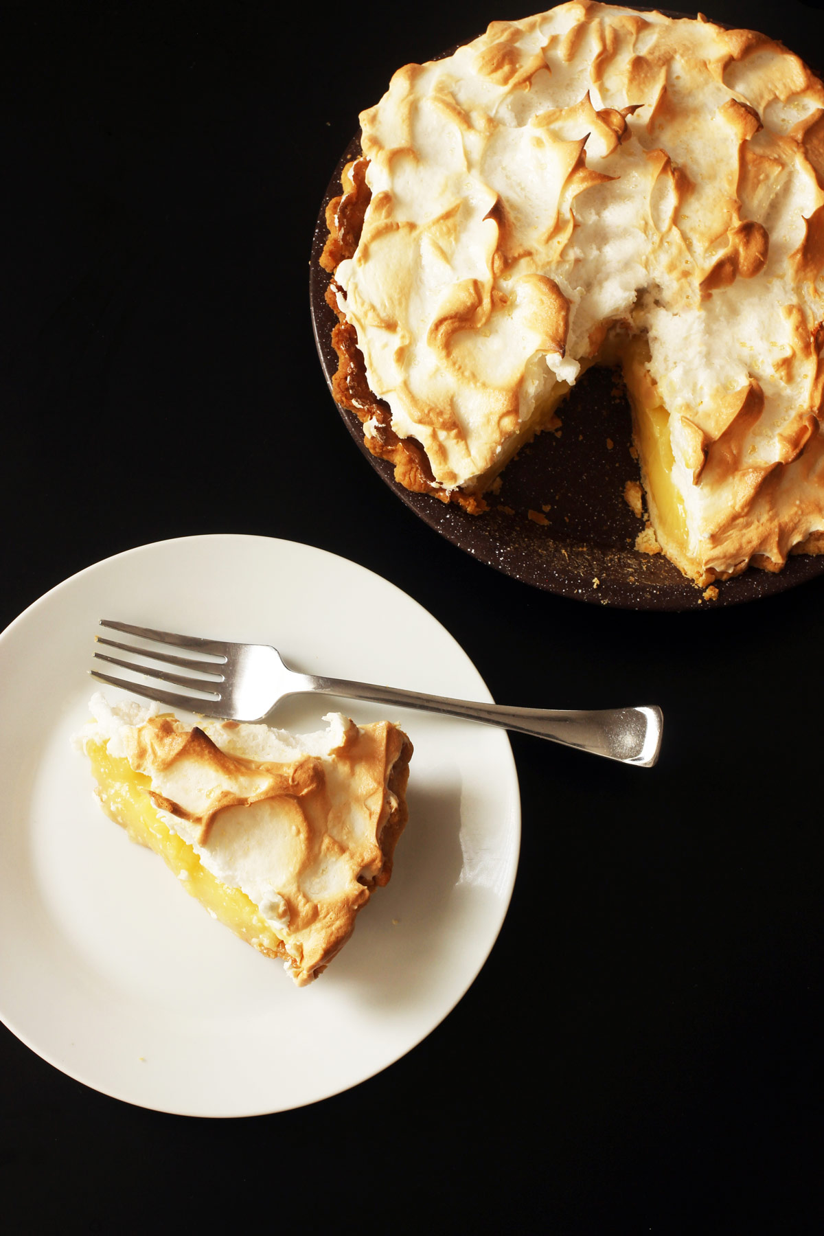 slice of pie on plate next to pie