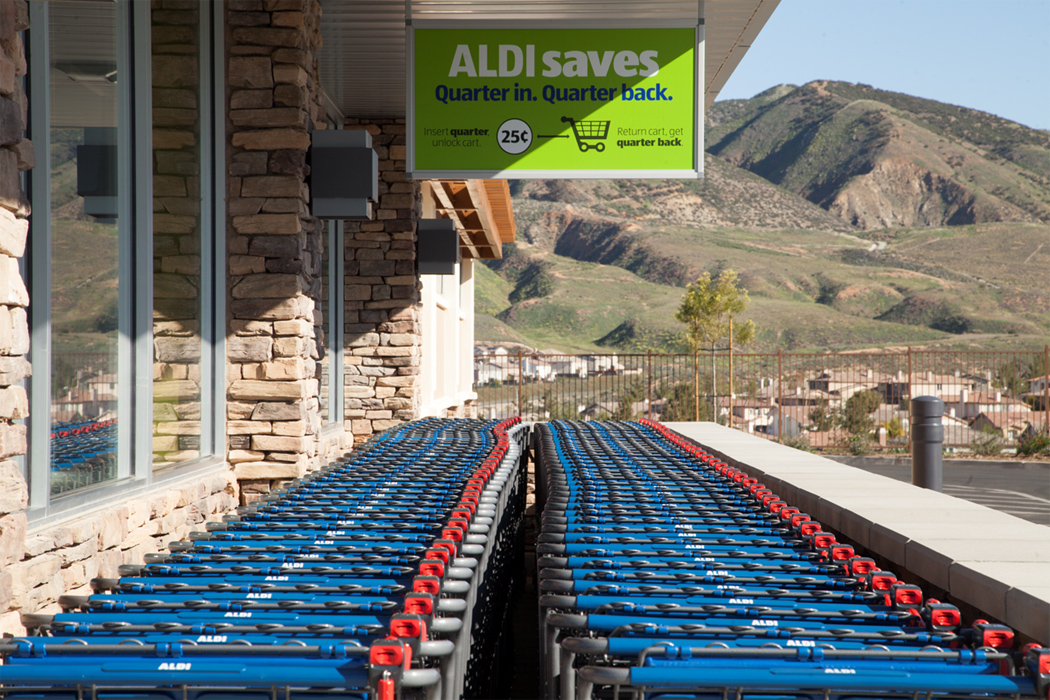 A line of carts on the side of an aldi store
