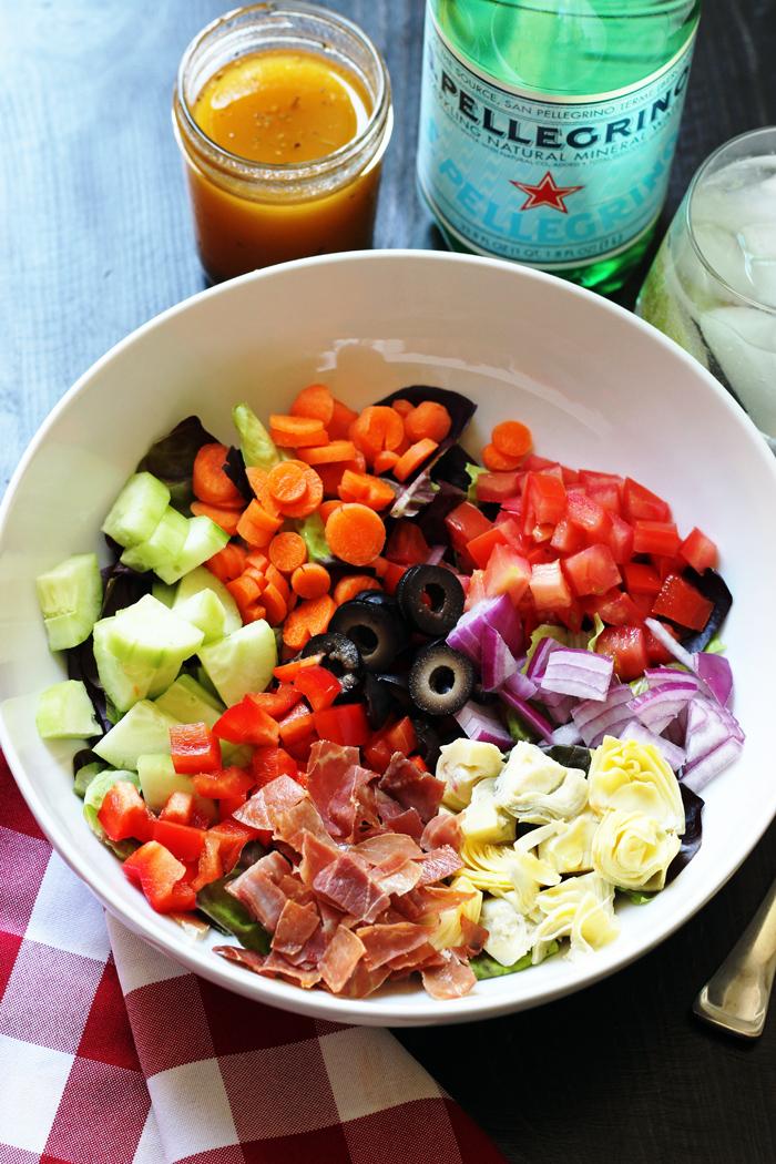 A bowl of Italian salad with crispy prosciutto