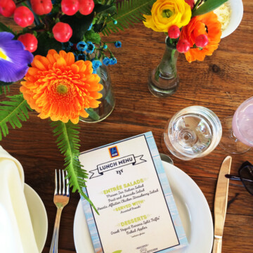A vase of flowers on a table, lunch hosted by Aldi