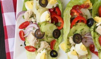niçoise lettuce wraps on white plate