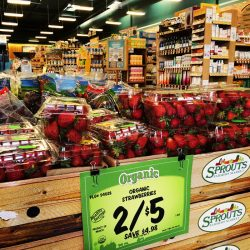 A bunch of strawberries on display in a store