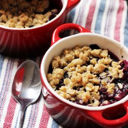 blueberry crumble on napkin with spoon