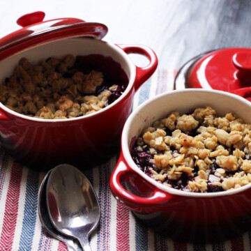 blueberry crumbles in ramekins on table