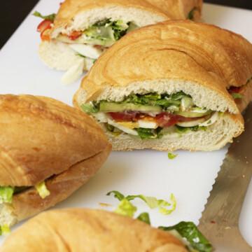 Large picnic sandwich cut into portions