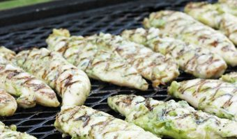 A close up of chicken on a grill