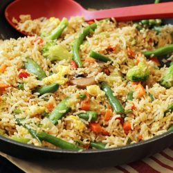 A pan filled with vegetable fried rice