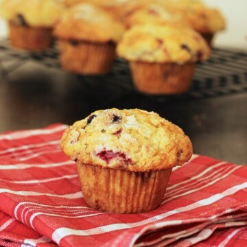 A muffin on red cloth on table