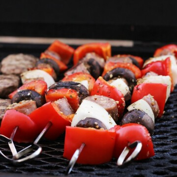 A close up of sausage kabobs on grill