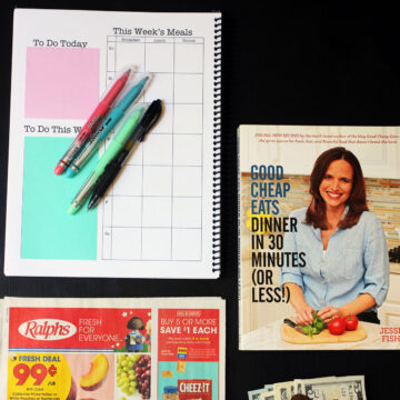 planner, grocery ad, cookbook, and money