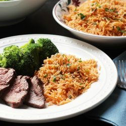 A plate of Chimichurri Rice and steak