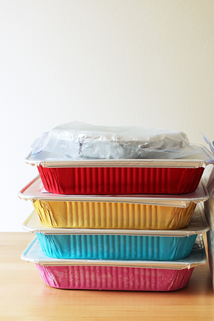 stack of freezer meals in colored baking pans
