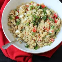 spoon resting in a bowl of quinoa salad