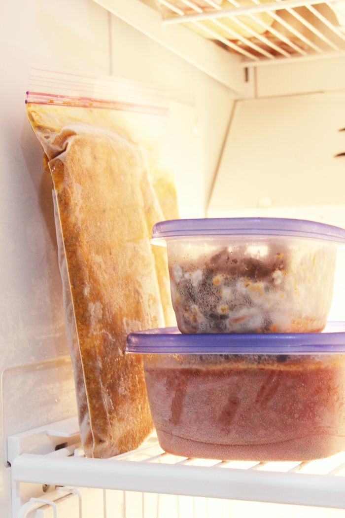 bag and boxes of frozen meals stacked in freezer