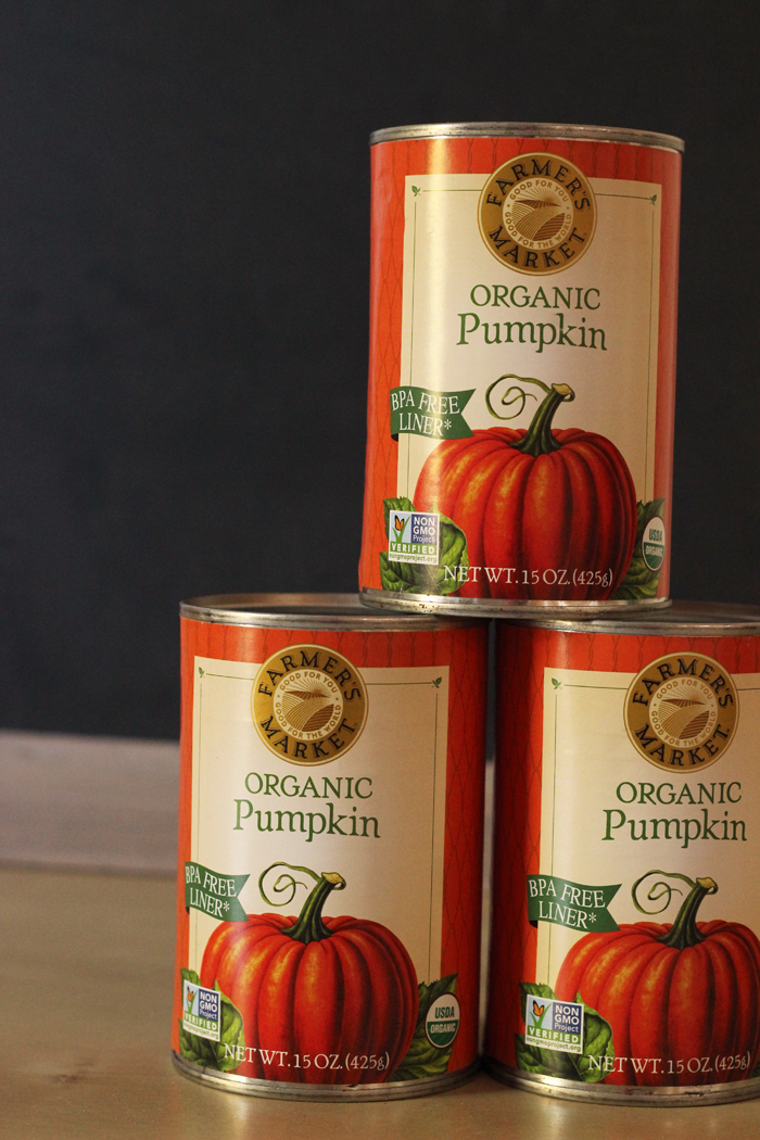stack of three cans of organic pumpkin