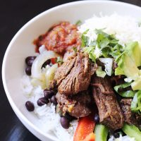 rice bowl with black beans and barbacoa beef