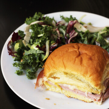 hot ham and swiss slider on plate with salad
