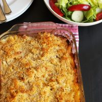 A casserole sitting on top of a wooden table