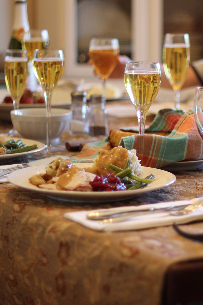 thanksgiving table set with full dinner plates