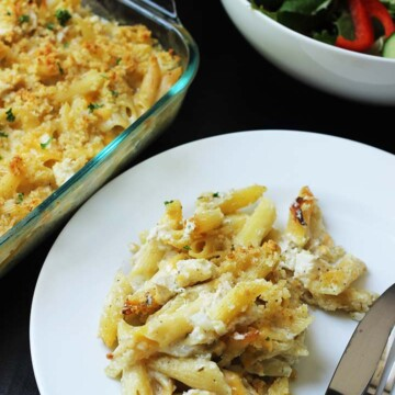 casserole dished onto plate near serving dishes