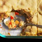 spoon in dish of pot pie