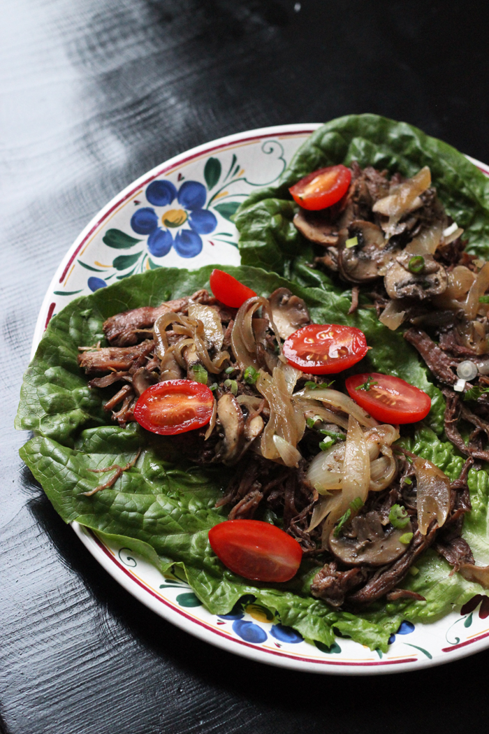 plate of French dip meat on lettuce wraps