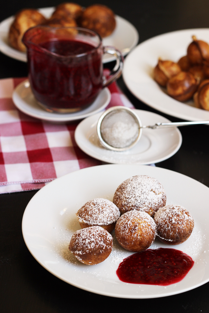 platter of aebleskiver with jam and sugar