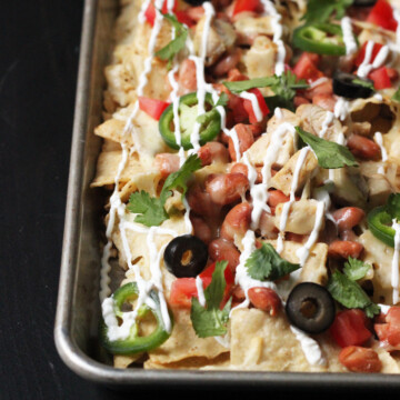 A close up of a tray of Nachos