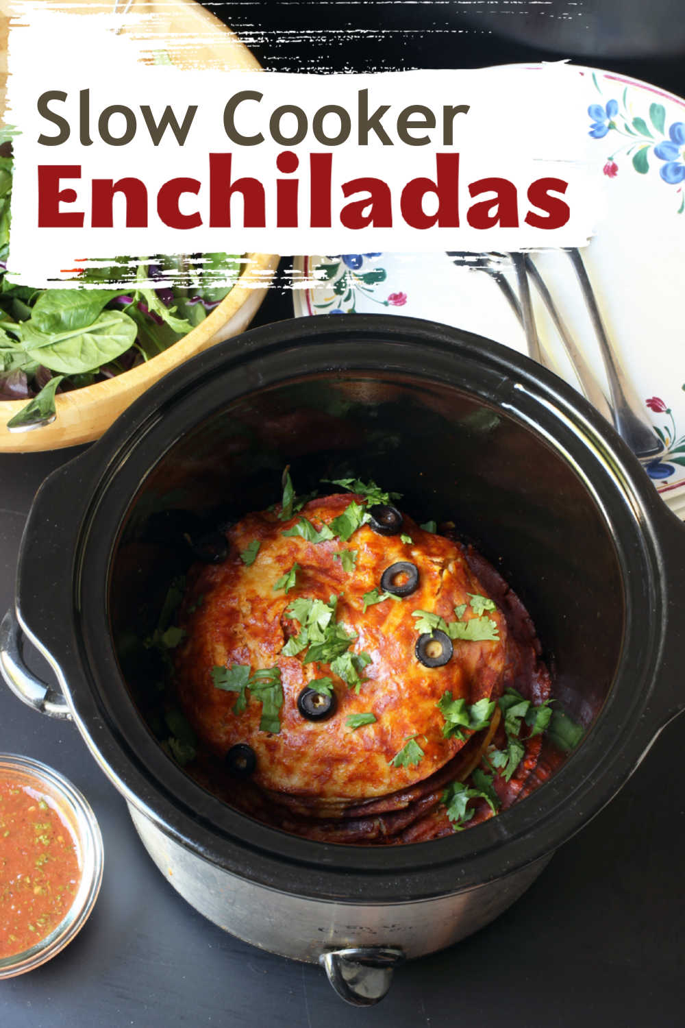 A Slow cooker full of stacked enchiladas