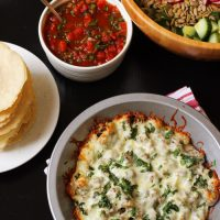 Dish of Queso Fundido with tortillas