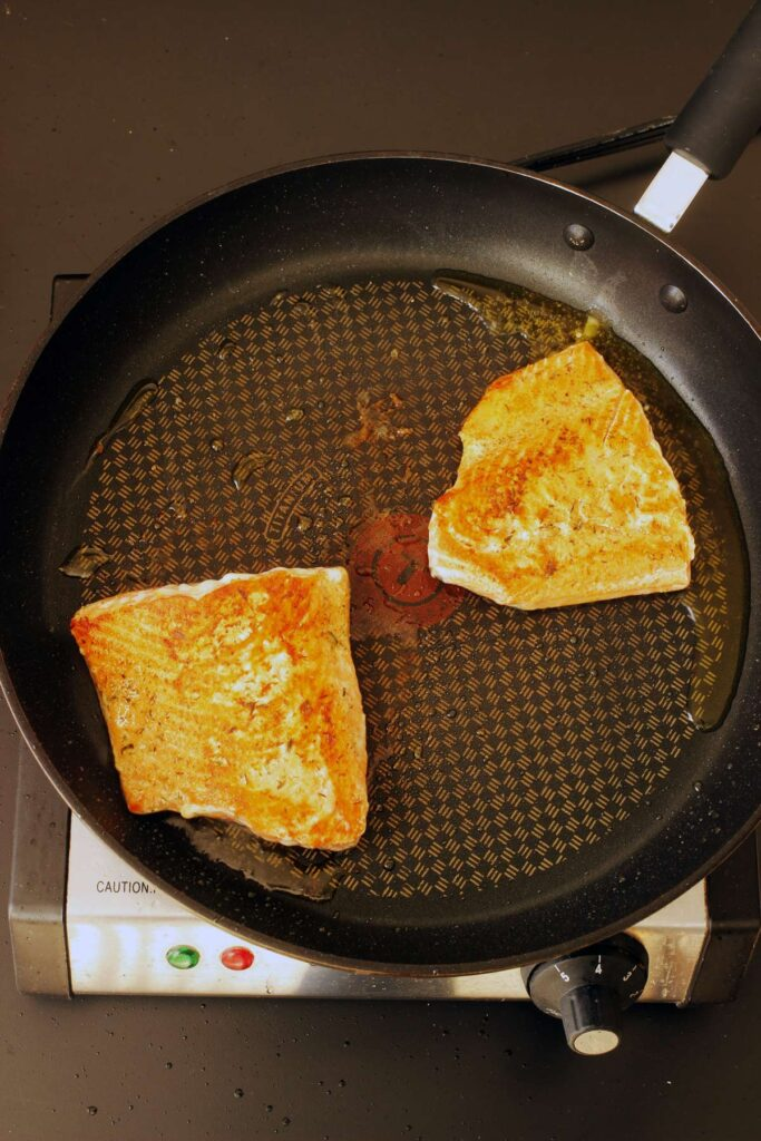salmon flipped skin down in skillet