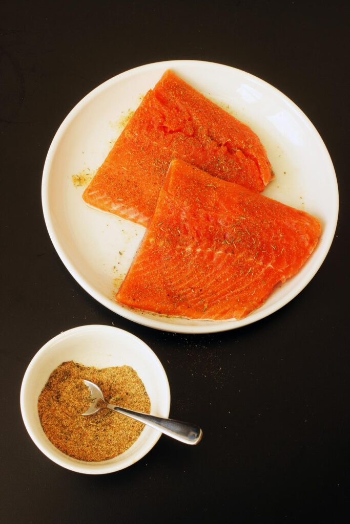salmon with fish rub sprinkled on it
