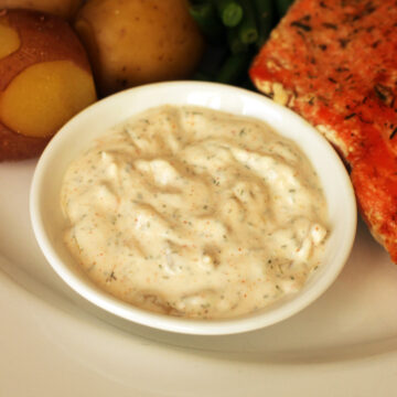 bowl of tartar sauce on dinner plate