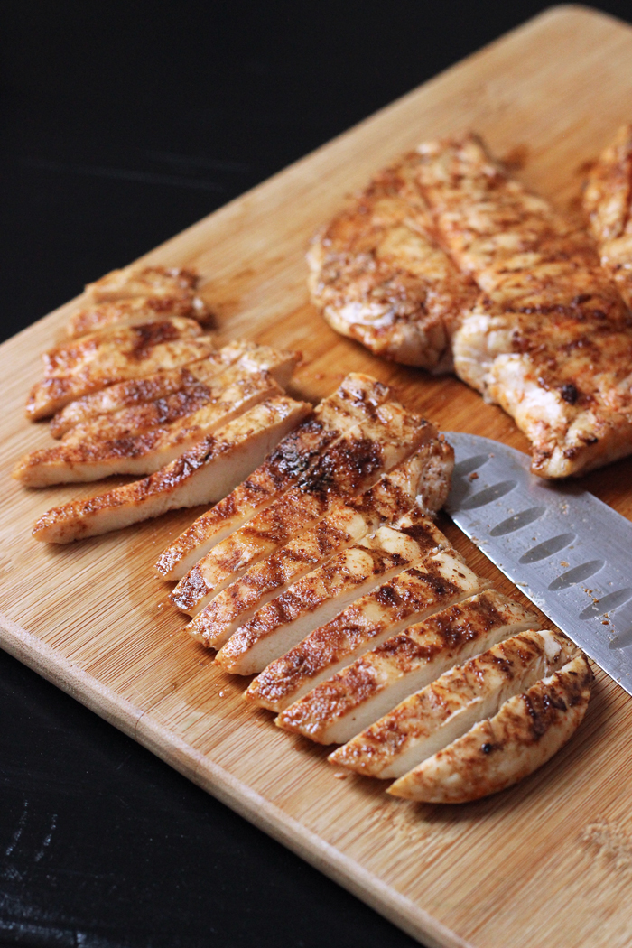Grilled Buffalo Chicken on a cutting board with a knife