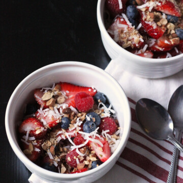 bowls of coconut berry salad, with spoons