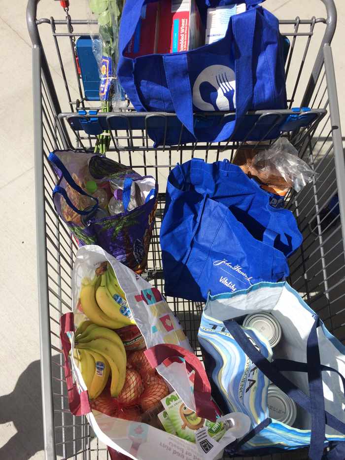 cart of grocery bags