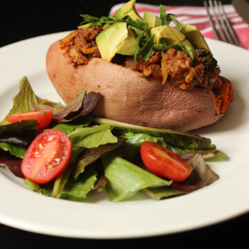 Stuffed potato on a plate, with salad