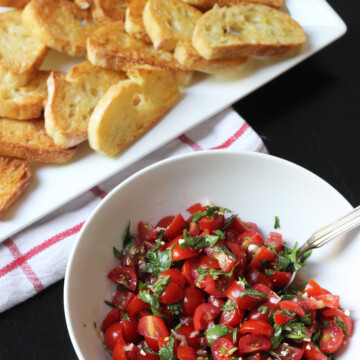 A plate of dippers with Tomato salad